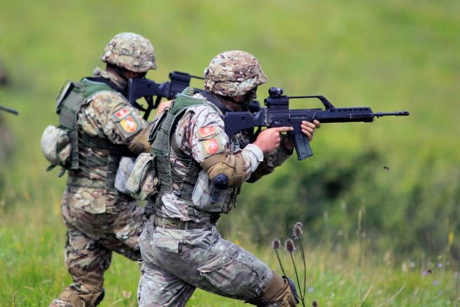 epa06089239 Soldiers from Montenegro take part at Combined Arms Live Fire Exercise, part of Saber Guardian 2017, at 'Getica' Center for Joint National Training in Cincu, 260 km north of Bucharest, central Romania, 15 July 2017. Exercise Saber Guardian 17 is a US European Command, US Army Europe-led annual exercise taking place in Hungary, Romania and Bulgaria in the summer of 2017. This exercise involves more than 25,000 service members from over 20 ally and partner nations. The largest of the Black Sea Region exercises, Saber Guardian 17 is a premier training event for U.S. Army Europe and participating nations that will build readiness and improve interoperability under a unified command.  EPA/BOGDAN CRISTEL