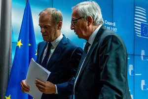 epa06278209 European Council President Donald Tusk (L) and EU Commission President Jean-Claude Juncker (R) leave after addressing a press briefing on the second day of the European Council Meeting in Brussels, Belgium, 20 October 2017. European leaders met in Brussels on 19 and 20 October 2017 to discuss most pressing issues, including migration, defence, foreign affairs and digitalisation and to review the latest developments in the negotiations following the United Kingdom's notification of its intention to leave the EU.  EPA/STEPHANIE LECOCQ