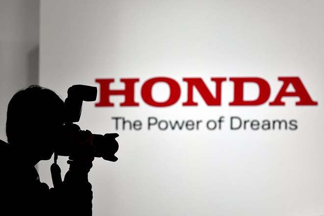 epa06301494 (FILE) - A photographer is silhouetted before the Honda Motor Co. logo during the 45th Tokyo Motor Show 2017 in Tokyo, Japan, 25 October 2017. Honda on 01 November 2017 released results of their second quarter and the fiscal first half year ended 30 September 2017, saying their consolidated profit for the fiscal first half year totalled 381.3 billion Japanese Yen or 2,87 billion euro, an  increase of 8.4 per cent from the same period last year. The sales revenue for the same period was 7,489 billion Japanese Yen or 56.4 billion euro.  EPA/FRANCK ROBICHON