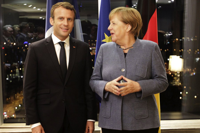 epa06232694 German Chancellor Angela Merkel (R) and French President Emmanuel Macron talk together during their meeting in Tallinn, Estonia 28 September 2017. The Tallinn Digital Summit is a platform to launch high-level discussions on further plans for digital innovation with the aim of keeping Europe ahead of the technological curve while becoming a digital leader, globally, in the years to come. The summit brings together EU heads of state or government on 29 September 2017.  EPA/VALDA KALNINA / POOL