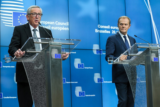 epa06278236 European Council President Donald Tusk (R) and EU Commission President Jean-Claude Juncker (L) address a press briefing on the second day of the European Council Meeting in Brussels, Belgium, 20 October 2017. European leaders met in Brussels on 19 and 20 October 2017 to discuss most pressing issues, including migration, defence, foreign affairs and digitalisation and to review the latest developments in the negotiations following the United Kingdom's notification of its intention to leave the EU.  EPA/STEPHANIE LECOCQ