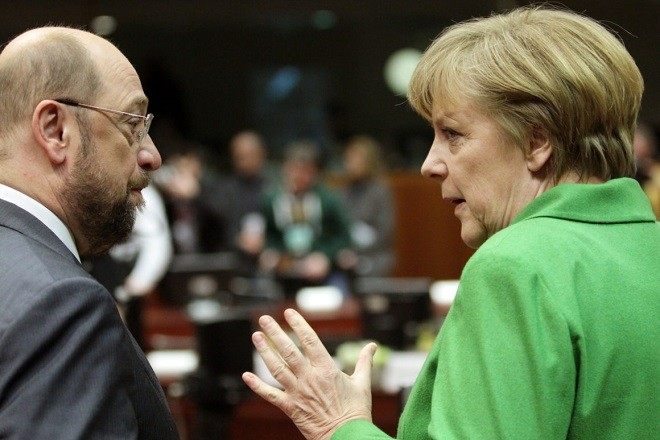 epa03624132  German Federal Chancellor Angela Merkel chats with  European Parliament President, German,  Martin Schulz during  European Council meeting at the European Council headquarters in Brussels, Belgium, 14 March 2013. The Council will discuss the economic situation and outlook, as well as foreign affairs, including the EU's relations with Russia and the conflicts in Syria and Mali.  EPA/OLIVIER HOSLET