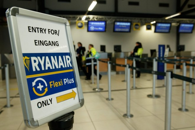 epa06384863 A view of the Ryanair airline check-in counter at the airport Berlin Schoenefeld, in Berlin, Germany, 12 December 2017. The pilots' union Vereinigung Cockpit (VC) announced that the pilots of the Ryanair would take part in the first industrial action. The announcement comes after pilots in Portugal and Italy had called their members to strike against the Irish company.  EPA/HAYOUNG JEON