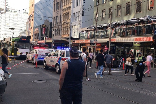 Police and emergency services attend the scene of an incident involving a vehicle on Flinders Street, as seen from Swanson Street, in Melbourne, Australia December 21, 2017.  AAP/Kaitlyn Offer via REUTERS    ATTENTION EDITORS - THIS IMAGE WAS PROVIDED BY A THIRD PARTY. NO RESALES. NO ARCHIVE. AUSTRALIA OUT. NEW ZEALAND OUT.?