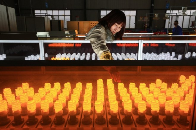 epa05238983 (FILE) A file photo dated 04 January 2016 showing a woman working on the production line of energy-saving lamps in a factory in Suining in southwest China's Sichuan province, China. China's industrial sector showed signs of expansion in March, after seven months of contraction, according to the Purchasing Managers' Index, PMI, published every month by the National Bureau of Statistics of China. The PMI rose to 50.2 points in March, up from February's 49 points. The indicator above 50 points marks the expansion of the manufacturing sector while the indicator below 50 reveals reduction in industrial activity. The National Bureau of Statistics also published 01 April 2016 the PMI of the service sector, which stood at 53.8 points after two months of a downward trend (53.5 points in January and 52.7 February).  EPA/ZHONG MIN CHINA OUT