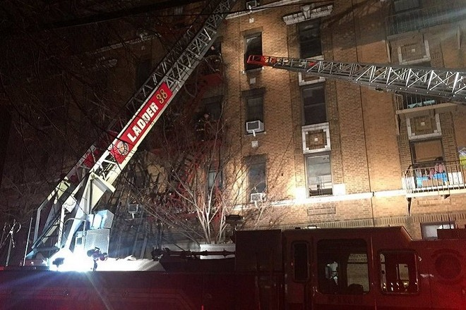 epa06408643 A handout photo made available by the Fire Department of the City of New York (FDNY) shows FDNY members operating at the scene of a four-alarm fire at an apartment building in the Bronx, New York, USA, 28 December 2017. At least six people were killed, including at least one child, and several others were injured after a fire broke out in a five-story building in the Bronx, media reported. More than 160 firefighters responded to the blaze, the fire department said. The cause of the fire is yet unknown. Mayor Bill de Blasio was said to be en route to the scene.  EPA/FDNY HANDOUT  HANDOUT EDITORIAL USE ONLY/NO SALES