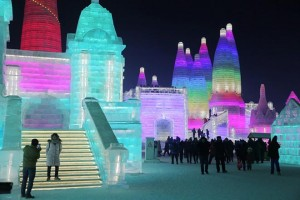 epa06418333 People visit the ice sculptures illuminated by coloured lights at Harbin ice and snow world during the opening of 34th Harbin International Ice and Snow Festival in Harbin city, China, 05 January 2018. Some 180,000 cubic meters of ice and 150,000 cubic meters of snow were used to build the 800,000-square-meter Harbin ice and snow world where the festival will last for about three months.  EPA/WU HONG