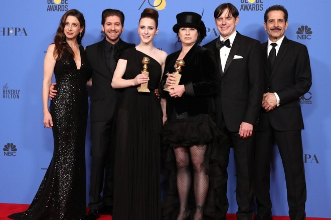 epa06424564 (L-R) Michael Zegen, Marin Hinkle, Rachel Brosnahan, Amy Sherman-Palladino, Daniel Palladino and Tony Shalhoub pose with the award for Best Television Series Musical or Comedy for 'The Marvelous Mrs. Maisel'  in the press room during the 75th annual Golden Globe Awards ceremony at the Beverly Hilton Hotel in Beverly Hills, California, USA, 07 January 2018. Brosnahan also holds her award for Best Actress in the same series.  EPA/MIKE NELSON