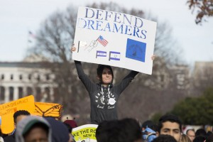 epa06372354 A youth holds a sign at a rally held to voice support for the passage of the 'clean' DREAM Act, in Washington, DC, USA, 06 December 2017. About two hundred protesters supporting a 'clean' DREAM Act were detained at the East Front of the Capitol, 06 December. A version of the Development, Relief, and Education for Alien Minors (DREAM) Act was first introduced to Congress in 2001 but has faced numerous obstacles since then. The Justice Department during the Trump administration has rescinded the Deferred Action for Childhood Arrivals (DACA) program.  EPA/MICHAEL REYNOLDS