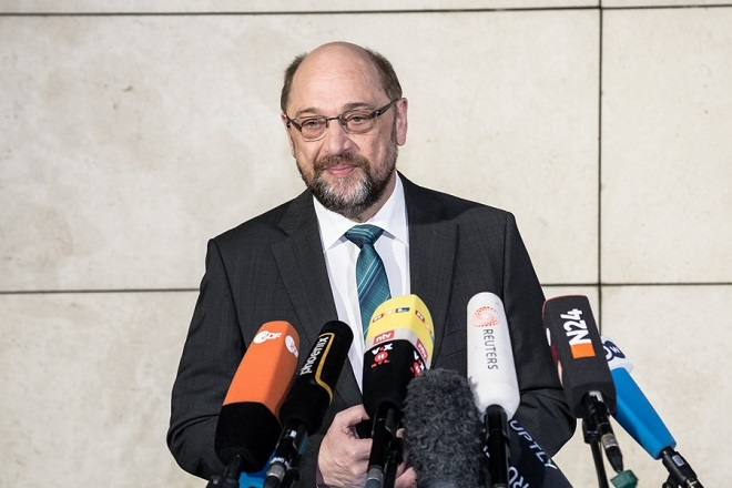 epa06430434 Leader of the German Social Democratic Party Martin Schulz (SPD), talks to the media prior to exploratory talks held at the Social Democrats party headquarters Willy-Brandt-Haus in Berlin, Germany, 11 January 2018. The leaders of CDU, CSU and SPD parties hold exploratory talks at the parties' headquarters through 11 January.  EPA/TILL RIMMELE