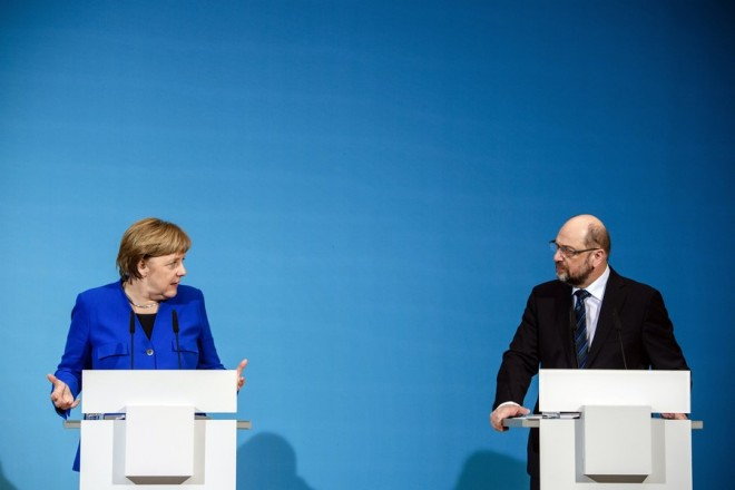 epa06432859 German Chancellor and Chairwoman of the Christian Democratic Union (CDU), Angela Merkel (L) and the leader of the Social Democratic Party (SPD), Martin Schulz (R) address a joint press conference after exploratory talks in Berlin, Germany, 12 January 2018. According to reports, the leaders of CDU, CSU and SPD parties after night-long talks agreed on a plan for formal coalition negotiations.  EPA/CLEMENS BILAN