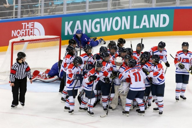epa05891329 The North Korean ice hockey squad reacts after defeating Britain 3-2 at the International Ice Hockey Federation (IIHF) Women's World Championship Division II Group A at the Gangneung Hockey Centre in, Gangneung, South Korea, 05 April 2017.  EPA/YONHAP SOUTH KOREA OUT
