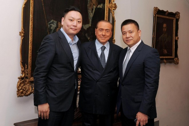 epa05906650 The new owner of AC Milan, Li Yonghong (R), with former president Silvio Berlusconi (C) and Li Han prior their dinner in the residency of Berlusconi in Arcore, Italy, 13 April 2017.The 31-year era of Silvio Berlusconi as AC Milan owner came to an end Thursday when Chinese businessman Li Yonghong formally became the owner. Berlusconi's holding company Fininvest closed a deal selling 99.93% of the seven-time European champion's shares to Luxembourg-based vehicle Rossoneri Sport Investment Lux, created ad hoc by the Chinese investor. 'Fininvest today finalised the sale to Rossoneri Sport Investment Lux of its entire stake, 99.93%, held in AC Milan', a joint statement said.  EPA/LIVIO ANTICOLI   EDITORIAL USE ONLY/NO SALES