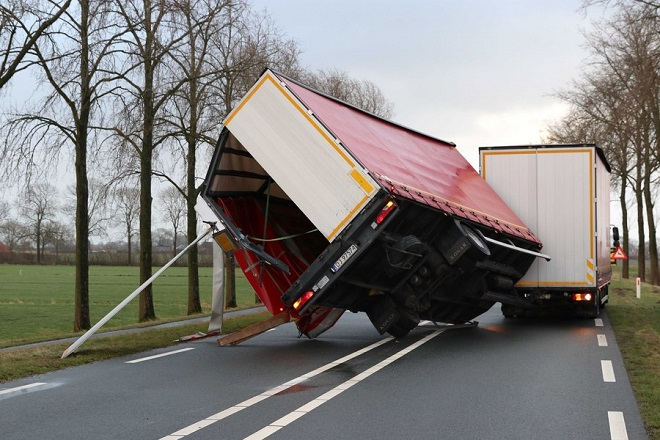 epa06449799 A lorry trailer following the strong winds of the western storm in Kampen, The Netherlands, 18 January, 2018, during the second western storm of the year. The Royal Netherlands Meteorological Institute (KNMI) has issued a code red for the storm that is expected to bring wind speeds up to 140 kph.  EPA/GINOPRESS B.V.