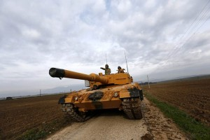 epa06459989 Turkish soldiers prepare their tanks near the Syrian-Turkish border, at Reyhanli district in Hatay, Turkey, 21 January 2018. Reports state that the Turkish army is on an operation (named 'Operation Olive Branch') in Syria's northern regions against the Kurdish Popular Protection Units (YPG) forces which control the city of Afrin. According to YPG media channels, bombings by the Turkish military killed at least 10 people earlier on the same day. Turkey classifies the YPG as a terrorist organization.  EPA/SEDAT SUNA