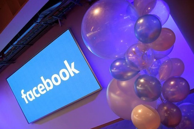 FILE PHOTO: Balloons are seen in front of a logo at Facebook's headquarters in London, Britain, December 4, 2017. REUTERS/Toby Melville/File Photo