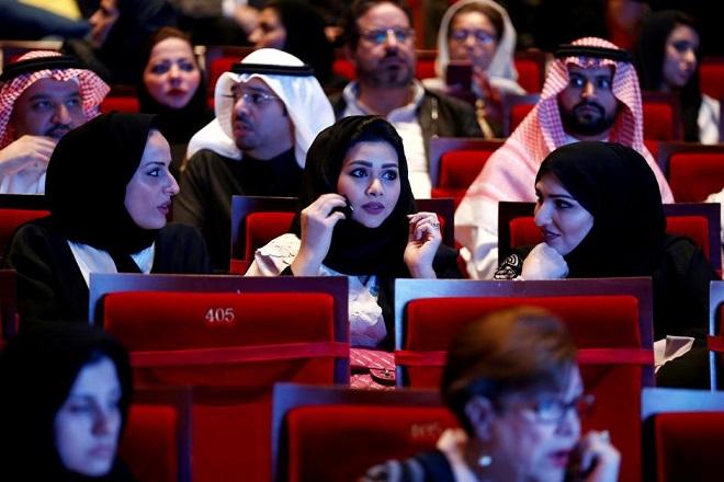 FILE PHOTO: Saudis watch composer Yanni perform at Princess Nourah bint Abdulrahman University in Riyadh, Saudi Arabia, December 3, 2017. REUTERS/Faisal Al Nasser/File Photo