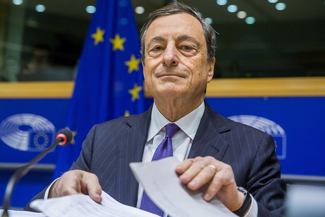 epa06340422 The President of the European Central Bank (ECB) and chairman of the European systemic risk Board, Mario Draghi, prepares papers during a hearing by the European Parliament Committee on Economic and Monetary Affairs, at the European Parliament in Brussels, Belgium, 20 November 2017.  EPA/STEPHANIE LECOCQ