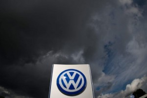 epa04944576 Dark clouds hover above a corporate logo of German car manufacturer Volkswagen in front of the Volkswagen plant in Wolfsburg, Germany, 23 September 2015. Volkswagen's board began a crisis meeting on 23 September that could decide the future of board chairman Martin Winterkorn, as Europe's biggest carmaker struggles to respond to a deepening emissions testing scandal. The carmaker's weekend admission that it had installed sophisticated software in its diesel models aimed at beating US exhaust tests has sent shockwaves through the German auto industry.  EPA/JULIANSTRATENSCHULTE