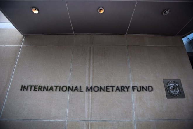 epa04824585 (FILE) A file photo dated 18 May 2011 showing the logo and name of the International Monetary Fund (IMF) at the entrance of the Headquarters of the IMF, also known as building HQ2, in Washington, DC, USA. Greece will not make the 1.6-billion-euro (1.8-billion-dollar) repayment due 30 June 2015 to the International Monetary Fund unless it strikes a deal in the coming hours with its creditors, Prime Minister Alexis Tsipras said in Athens as the deadline loomed. He implied that his left-wing government would resign if Greeks vote 'yes' in a planned 05 July referendum on a renegotiated bailout. The Greek vote is widely seen as deciding whether the near-bankrupt country stays in the eurozone. No country has left the currency bloc since its founding in 1999.  EPA/JIM LO SCALZO *** Local Caption *** 51301299