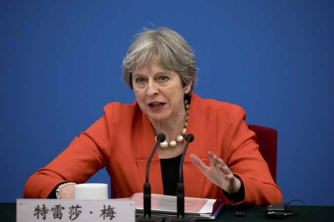 epa06487702 British Prime Minister Theresa May speaks during the inaugural meeting of the UK-China CEO Council at the Great Hall of the People in Beijing, China, 31 January 2018. May is leading the largest business delegation her government has ever taken overseas as she seeks to put her Brexit troubles aside and make progress on boosting Britain's trade.  EPA/MARK SCHIEFELBEIN / POOL
