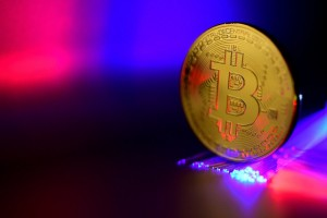 epa06407075 A Bitcoin is pictured in Duesseldorf, Germany, 27 December 2017. Wild swings in the price of bitcoin took a pause, after it temporarily dropped to 10,800 US dollar. The cryptocurrency's value plummeted by nearly a third last week, and was dealt another potential blow when the Israeli Securities Agency said it would bar companies trading in bitcoin from operating on the Tel Aviv stock exchange and investigate how to regulate the digital currency because of concerns about volatile prices.  EPA/SASCHA STEINBACH