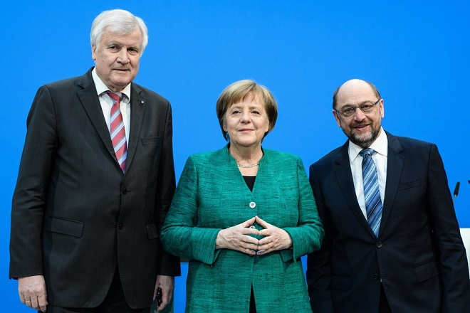 epa06502975 (L-R) Minister President of Bavaria Horst Seehofer of the Christian Social Union (CSU), German Chancellor Angela Merkel of the Christian Democratic Union (CDU) and Leader of the Social Democratic Party (SPD) Martin Schulz during a press statement following coalition talks held at the CDU headquarters Konrad-Adenauer-Haus, in Berlin, Germany, 07 February 2018. German media reports on 07 February 2018 state Horst Seehofer may according to unconfirmed reports become the new German interior minister, a position that may be expanded to include homeland affairs and construction. Martin Schulz, who is also the former president of the European Parliament, may according to unconfirmed reports become the new German foreign minister, replacing current foreign minister Sigmar Gabriel. The three German parties, conservative CDU, CSU and social democratic SPD have been conducting coalition talks to form a new government, four months after the general election in September 2017.  EPA/CLEMENS BILAN