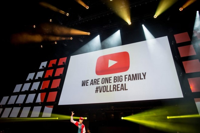 epa05498915 The words 'We Are One Big Family #Vollreal' and the YouTube logo are projected on a screen at the 'VideoDays', the biggest YouTuber meeting in Europe, in Cologne, Germany, 19 August 2016.  EPA/MAJA HITIJ