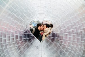 epa06490534 A couple kiss for a photo in ArandaLasch + Marcelo Coelho's 'Window to the Heart' in Times Square in New York, New York, USA, 01 February 2018. The 12 foot in diameter sculpture was designed with 3D printing and will be free and open to the public through the month of February, in celebration of Valentine's Day.  EPA/ALBA VIGARAY