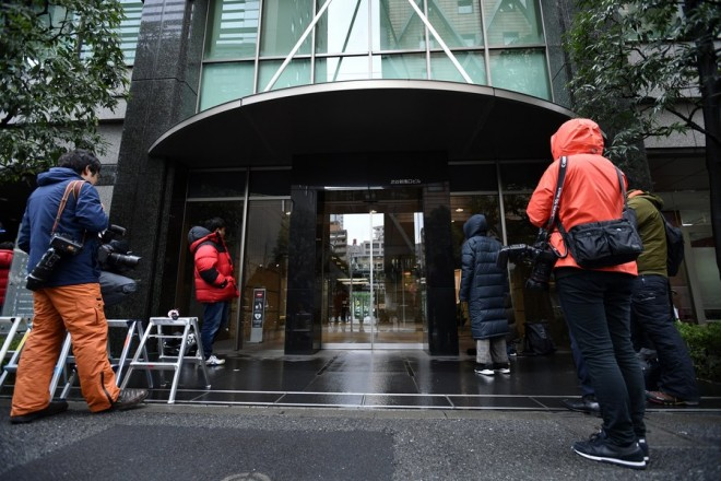 epa06491050 Japanese reporters wait before the building hosting cryptocurrency exchange Coincheck Inc.'s offices in Tokyo, Japan, 02 February 2018. Earlier in the day, Japan's Financial Services Agency (FSA) inspected cryptocurrency exchange Coincheck offices a week after hackers stole more than 500 million US dollars from the company. It is the first time that the FSA operates to an on-site inspection for virtual currency exchanges.  EPA/FRANCK ROBICHON