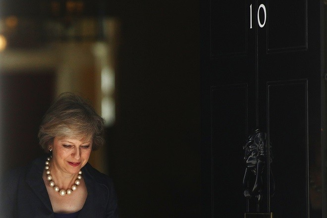 Theresa May, U.K. home secretary, departs a cabinet meeting in 10 Downing Street in London, U.K., on Tuesday, July 12, 2016. May now has just two days rather than two months to build a team to rescue the U.K. from its worst political crisis in a generation and begin extricating it from the European Union. Photographer: Chris Ratcliffe/Bloomberg via Getty Images