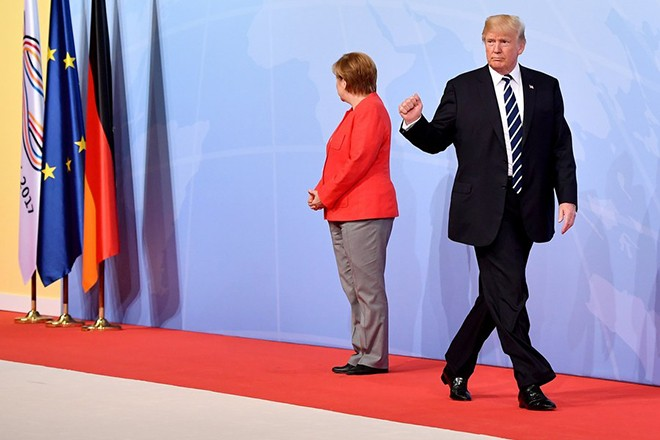 epa06260351 YEARENDER 2017 JULY German Chancellor Angela Merkel (L) welcomes US President Donald J. Trump (R) during the official reception to the opening day of the G20 summit in Hamburg, Germany, 07 July 2017. The G20 Summit (or G-20 or Group of Twenty) is an international forum for governments from 20 major economies. The summit took place in Hamburg 07 to 08 July 2017.  EPA/LUKAS BARTH