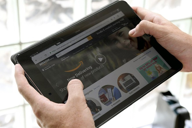 epa06370312 A tablet is seen displaying Amazon's Australian website in Sydney, New South Wales, Australia, 05 December 2017. Amazon has launched in Australia, ending months of speculation around the timing of when it would finally open its full offering Down Under and setting up a sales frenzy ahead of Christmas.  EPA/DAN HIMBRECHTS  AUSTRALIA AND NEW ZEALAND OUT