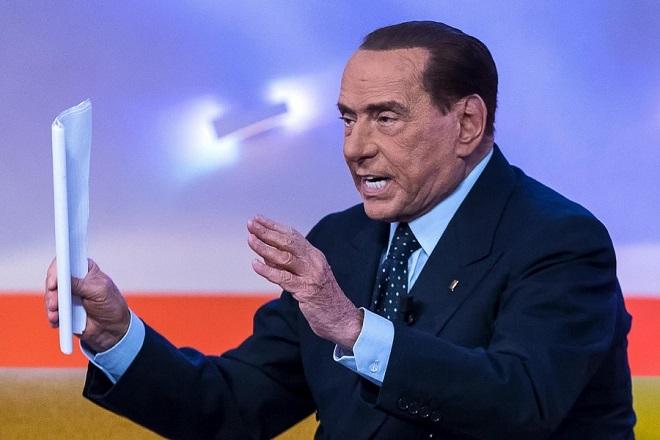 epa06528946 Italian former Prime Minister and Forza Italia (FI) leader Silvio Berlusconi (R) attends the La7 TV program 'Tagada' hosted by journalist Tiziana Panella in Rome, Italy, 15 February 2018. Italy will hold general elections on 04 March.  EPA/ANGELO CARCONI