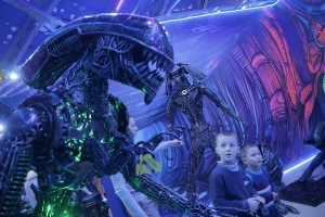 epa05698029 Visitors look at exhibits in a hall dedicated to the Hollywood movie 'Alien vs. Predator' at the 'Revolt of Machines' Museum during the New Year holiday in Moscow, Russia, 04 January 2017.  EPA/MAXIM SHIPENKOV