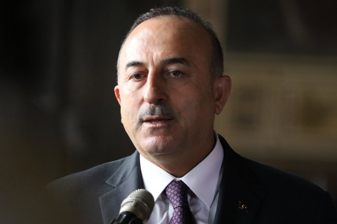 epa06419942 Turkish Foreign Minister Mevlut Cavusoglu speaks during a media briefing in Goslar, Germany, 06 January 2018. German Foreign Minister Gabriel has invited his Turkish counterpart Cavusoglu for a return visit to his hometown in the Harz region.  EPA/FOCKE STRANGMANN