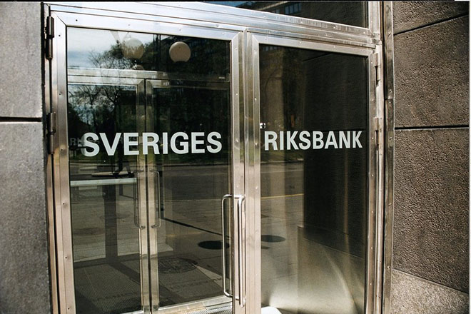 epa04615632 A undated handout image made available by Sweden's central bank, Sveriges Riksbank, on 12 February 2015 showing the main entrance of the central bank building in Stockholm, Sweden. The Swedish central bank on 12 February 2015 lowered its key interest rate to a record low of minus 0.10 per cent and announced a bond-buying programme, citing that a more expansionary policy could help push up inflation. The cut - effective as of 11 February - aimed at increasing inflation which has flattened out amid lower oil prices and uncertain economic recovery abroad, the Riksbank said. The central bank's inflation target is 2 per cent, while underlying inflation was this year projected at 0.9 per cent. The repo rate is the interest rate that commercial banks borrow or deposit money for 7 days at the Riksbank. The negative rate means that banks have to pay money for keeping deposits with the Swedish central bank. The repo rate was last lowered in October when it was cut to 0 per cent.  EPA/SVERIGES RIKSBANK / HANDOUT  HANDOUT EDITORIAL USE ONLY/NO SALES