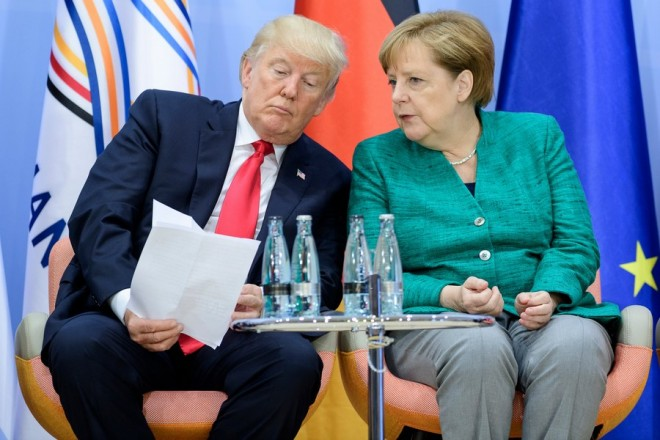 epa06075279 US President Donald J. Trump (L) and German Chancellor Angela Merkel (R) attend the the launch event of the 'Women's Entrepreneurship Facility' within the  second day of the G20 summit in Hamburg, Germany, 08 July 2017. The G20 Summit (or G-20 or Group of Twenty) is an international forum for governments from 20 major economies. The summit is taking place in Hamburg 07 to 08 July 2017.  EPA/MICHAEL UKAS / POOL