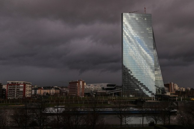 epa06445800 A general view of the building of the European Central Bank (ECB) under dark clouds in Frankfurt/Main, Germany, early 17 January 2018. Meteorologist predict the cloudy weather with temperatures of around two degrees Celsius to continue in the next days.  EPA/ARMANDO BABANI