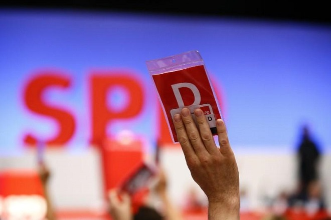 A delegate of the German Social Democratic party (SPD) votes during the party convention in Dortmund, Germany, June 25, 2017. REUTERS/Wolfgang Rattay