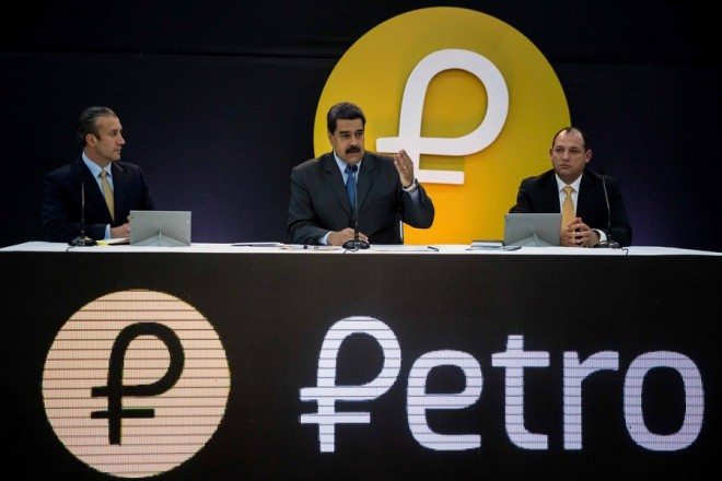 epa06547989 President of Venezuela Nicolas Maduro (C), Venezuelan vice president Tareck El Aissami (L) and Venezuelan minister for University Education, Science and Technology Hugbel Roa (R) attend a governmental event at the Miraflores palace in Caracas, Venezuela, 20 February 2018. Maduro announced that the pre-sale of the national cryptocurrency 'Petro' reached 735 million US dollars since its launch at midnight on the day before. This Venezuelan cryptocurrency is backed by 5,342 million barrels of crude oil and its price is subject to the value of the Venezuelan barrel, which in recent days ranged around 60 US dollars.  EPA/MIGUEL GUTIERREZ