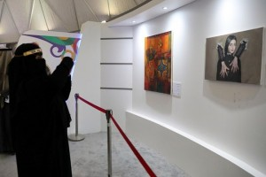 epa06533962 A Saudi woman takes a photo of a painting by Saudi artist Sabah Al-Dhafiri at an art exhibit of Al-Janadria festival near Riyadh, Saudi Arabia, 16 February 2018. Al-Janadria festival is the biggest cultural heritage festival  held in Saudi Arabia, the 2018 edition opened on 07 February for 4 days to men only, then to families which translates to a mixed gender attendance. A few days after it opened though, the authorities announced it would last three weeks longer to enable Saudi people to enjoy visiting its government pavilions, cultural shows and exhibits and various entertainment representations present this year. The 2018 edition of the festival bore a fair atmosphere where Saudis get to have fun where it was frowned upon before, as part of the changes the countries has seen since 2017.  EPA/AMEL PAIN