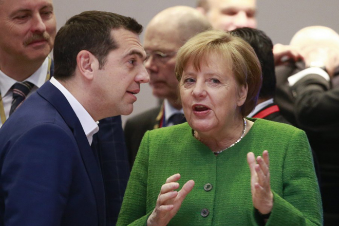 epa06557573 German Chancellor Angela Merkel and Greek Prime Minister Alexis Tsipras (L) prior to the Informal meeting of the 27 European Heads of States of Governments in Brussels, Belgium, 23 February 2018. The 27 European Heads of States of Governments will discuss on the new composition of the European Parliament after the so-called 'Brexit' and a post-2020 EU budget for several years.  EPA/OLIVIER HOSLET