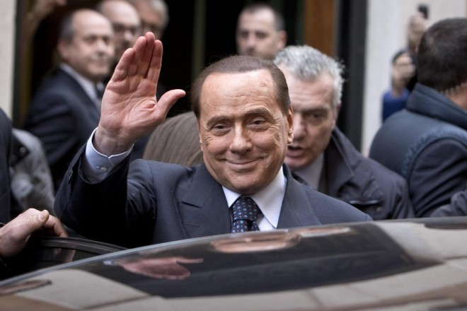 epa04087982 The head of the center-right Forza Italia party, Silvio Berlusconi, waves at the end of his meeting with Italian premier-designate Matteo Renzi, as he exits Parliament offices in Rome, Italy, 19 February 2014. Democratic Party (PD) leader and premier-designate Matteo Renzi continued a round of talks with Italy's political parties in view of the formation of a new government.  EPA/MASSIMO PERCOSSI