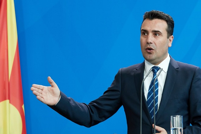 epa06549961 Prime Minister of the Former Yugoslav Republic of Macedonia Zoran Zaev talks to media during at a joint press conference with German Chancellor Angela Merkel  (unssen) at the Chancellery in Berlin, Germany, 21 February 2018. The first bilateral meeting between Zaev and German Chancellor Merkel took place on the sidelines of the EU-Western Balkans Summit in July 2017.  EPA/HAYOUNG JEON