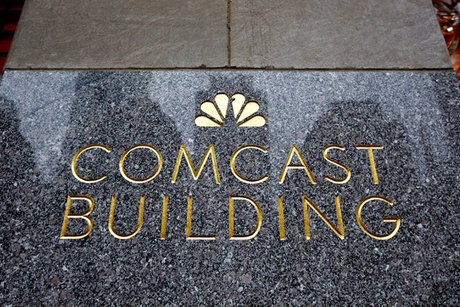 epa05141876 A view of a sign on the Comcast Building in New York, New York, USA, on 03 February 2016. The company reported better than expected earnings on 03 February.  EPA/JUSTIN LANE