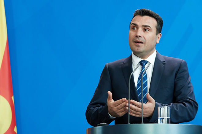 epa06549956 Prime Minister of the Former Yugoslav Republic of Macedonia Zoran Zaev talks to media during at a joint press conference with German Chancellor Angela Merkel  (unssen) at the Chancellery in Berlin, Germany, 21 February 2018. The first bilateral meeting between Zaev and German Chancellor Merkel took place on the sidelines of the EU-Western Balkans Summit in July 2017.  EPA/HAYOUNG JEON