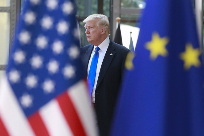 epa05988265 US President Donald J. Trump is welcomed by European Council President Donald Tusk (concealed) ahead of a meeting with EU leaders at the European Council, in Brussels, Belgium, 25 May 2017. Trump is in Belgium to attend a North Atlantic Treaty Organization (NATO) Summit and to meet EU leaders.  EPA/OLIVIER HOSLET