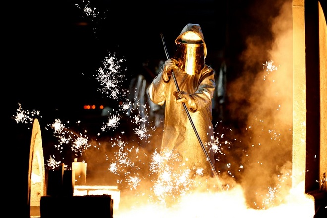 epa06574136 (FILE) - A steel worker takes a steel sample at blast furnace 8 of German corporation ThyssenKrupp in Duisburg, Germany, 07 April 2017 (re-issued 02 March 2018). Media reports on 02 March 2018 state the European Union would plan to retaliate should USA go ahead with their plans to impose national tariffs on steel and aluminium imports from around the globe, as announced by US President Donald Trump on 01 March 2018. The announcement sent stocks around the globe lower, amid fears of a possible trade war between USA, China and the EU.  EPA/FRIEDEMANN VOGEL