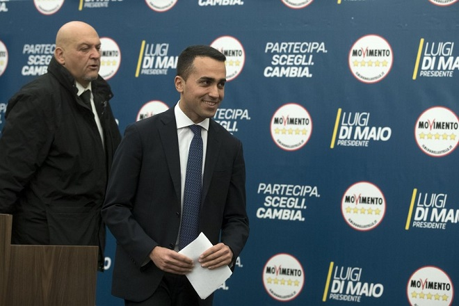 epa06582301 Luigi Di Maio (C), the Italian 5-Star Movement's leader, arrives to deliver a speech during a news conference in Rome, Italy, 05 March 2018. The anti-establishment 5-Star Movement (M5S) scored a 'triumph' thanks to 11 million Italians in the 04 March general election and was ready to 'talk to all parties' on its government agenda, Di Maio said. Others are not identified.  EPA/MASSIMO PERCOSSI